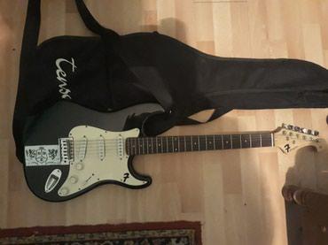 Tenson kao nova elektricna gitara...samo zameniti zice...ide sa - Vrnjacka Banja