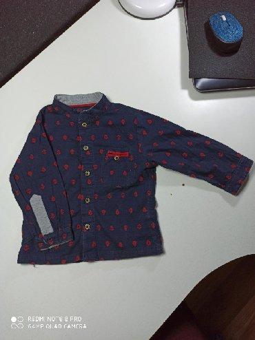 Рубашка на мальчика в отличном состоянии. На 1 год. Куплена в