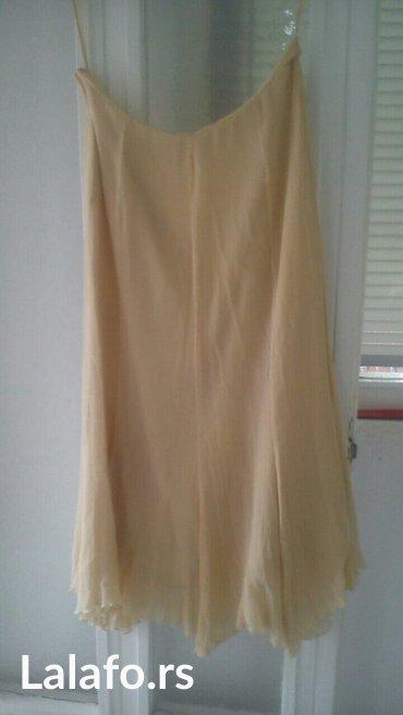 Suknja patrizia - Srbija: Suknja, br.44obim 85cm,duzina 86cm,na je u gloh,dole ima spicevibez