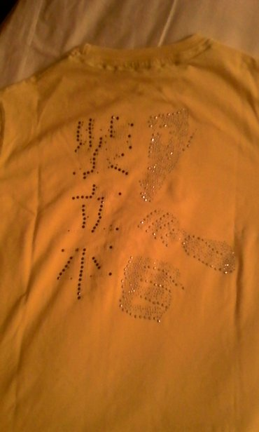 Muska majca de putra madre limun zute boje sa cirkonima. Duzina majce  - Beograd