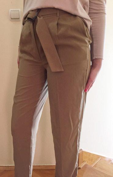 Boja krem sako - Srbija: OVS pantalone sa dubokim strukom i snalom kupljene u Austriji.  Velici