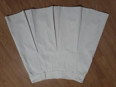 Zuta-sujnjica-svega-dva-struk-cm - Srbija: Slatka bež suknjica sa faltama,duz.50 cm,struk 40 cm,vel.44