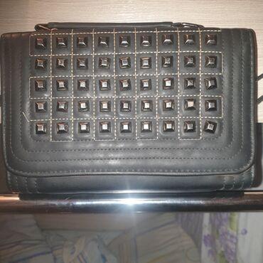 Абсолютно новая,стильная сумочка!Подарили не носила,очень сильно