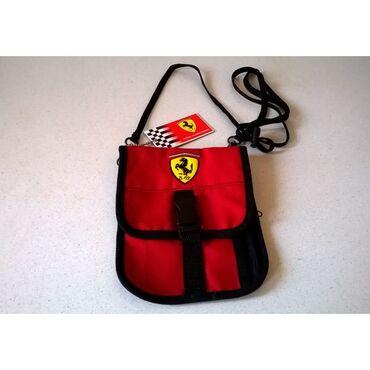 Τσαντάκι Ferrari / Καινούργιο  Διαστάσεις: 19 x 15 εκατ