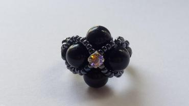 Handmade with 4 black round onyx beads (8mm) and of 1 strass in the