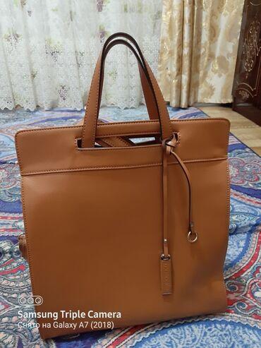 Кожанная сумка,почти новая,состояние отличное. 2000 отдам покупала за