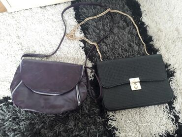 Obe torbe za 1200 crna nova nije nosena a ljubicasta nosena par puta