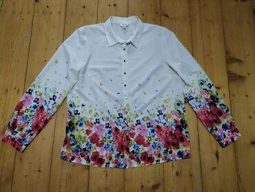 Новая. Нарядная блузка. Размер 42. Фирма Koton
