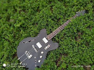 İdman və hobbi Naftalanda: Jolano gitara satılır süper tempr yigilib renglenib profesyonel aletdi