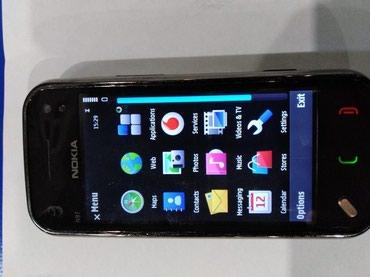 Nokia n97 mini prodajem je kao neispravnu jer mi je dete pokusao da - Krusevac