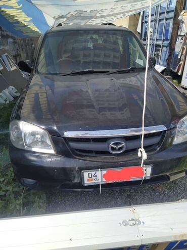 Автомобили - Токтогул: Mazda 3 л. 2004