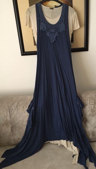 Moze da se nosi kao dve odvojene haljine,rastegljive su