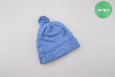 Жіноча шапка з помпоном     Напівобхват голови: 24 см Висота: 21 см  С