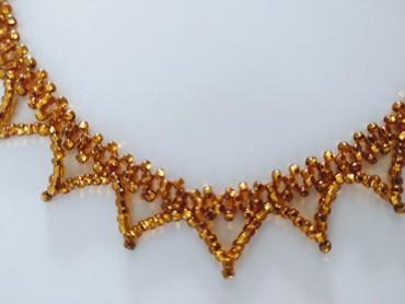 Ogrlica, ručno radjena, zlato - oker žute boje 39 cm dugačka. - Palic