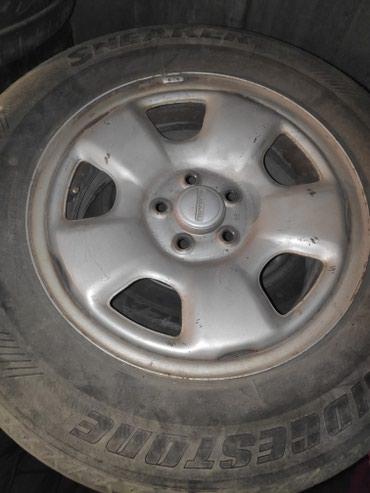 железные диски на 15 в Кыргызстан: Железные диски на Субару на 15,резина летняя состояние так себе