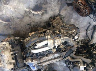 Продаю на Мазду двигатель с коробкой с навесными комплект  в Бишкек