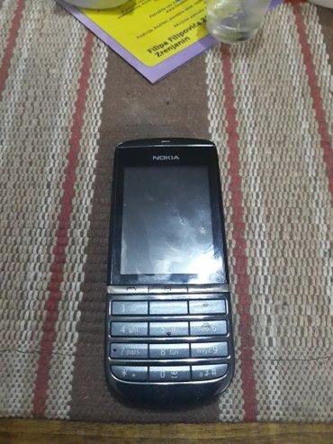 Nokia asha 300, problem u touch creen-u. Nije ostecen i slicno, - Zrenjanin