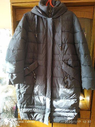 Продам теплую женскую куртку новую из натурального био пуха фирма