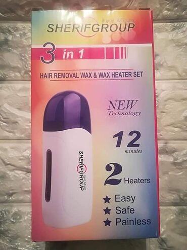 Paket sadrzi - Srbija: Set za depilaciju sadrzi jedan aparat za topljenje voska, jednu