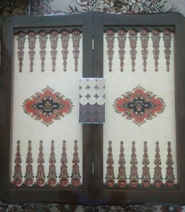 Nərd Taxta satılır. Fıstıq ağacındandır. Diplomat çantasında daşları