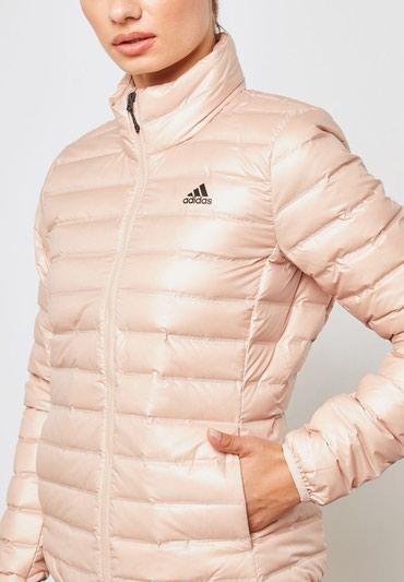 Пуховая куртка из коллекции adidas Performance. Слегка утепленная