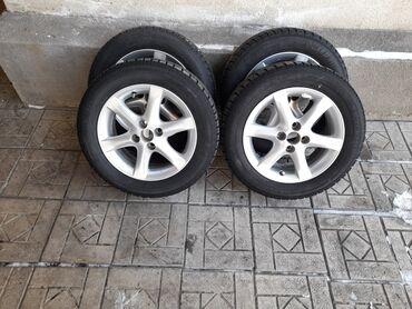 Продаю диски вместе с резиной размер 15 размер резины 195/60 R15 в