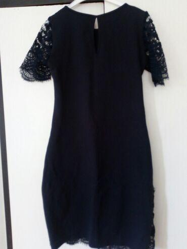Haljine   Bogatic: Elegantna haljina od cipke. Teget plave boje. L-Xl velicine. Mada je