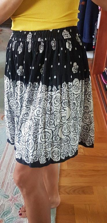 Prelepa plisirana suknja zaista divnog materijala poput svilenog. - Belgrade