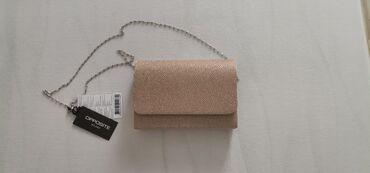10129 oglasa: Nova Opposite torba sa etiketom