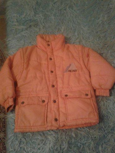 Decija zimska jakna odlicno ocuvana. Narandzaste boje. - Valjevo