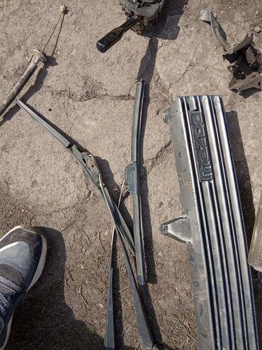 Прозрачные решетки на окна цена - Кыргызстан: Мазда старушка вары,стопник, решетка амортизатор передний,печки