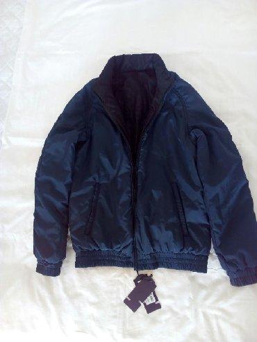 Новая куртка двухсторонняя. Водонепроницаемая, легкая, теплая. Одна