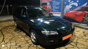 Mazda - Кыргызстан: Mazda Familia 2 л. 2002   33333 км