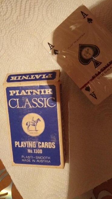 Nove karte za igru,jos su u omotu,spil 400 dinara. Karte su klasicne