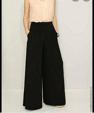 Личные вещи - Токмок: Широкие чёрные брюки,турецкий 42размер. Одевала пару раз.Прошу 500 в