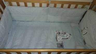 komplet posteljina sa ogradicom za krevetac +prostirka koja moze i u k - Pozarevac