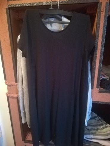 Crna haljina iznad kolena. - Nis
