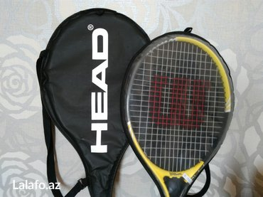 "Bakı şəhərində Head 25'"" tennis racket and cover, suitable for 8-10 year olds."