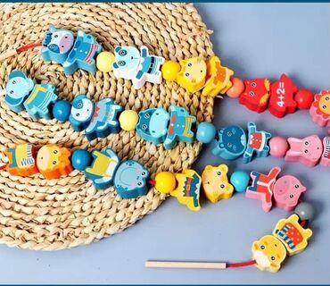 Развеивающая игра «Бусы». Обучает цифрам, цветам, формам и животным