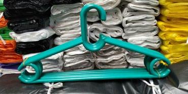распродажа остатков одежды в Кыргызстан: ВЕШЕЛКА шт. качественный гелевый вешалки для тяжелых одежд. тел