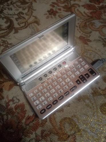 Электронные книги - Кыргызстан: Продаю электронный переводчик. С разговорником. Зарядка от сети на