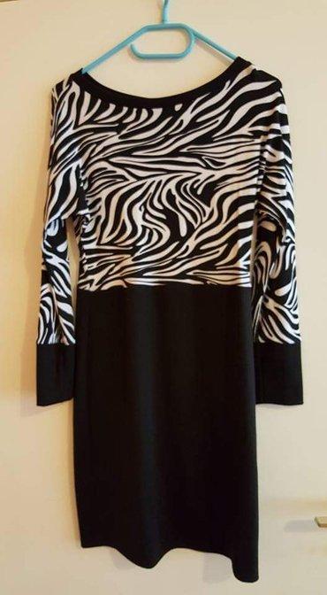Haljina ima dosta elastina kao nova.Duzina 90cm sirina 45cm a poluobim - Belgrade