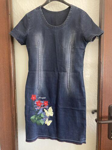 Prelepa teksas haljinica, naznacena vel. L ali vise odgovara za
