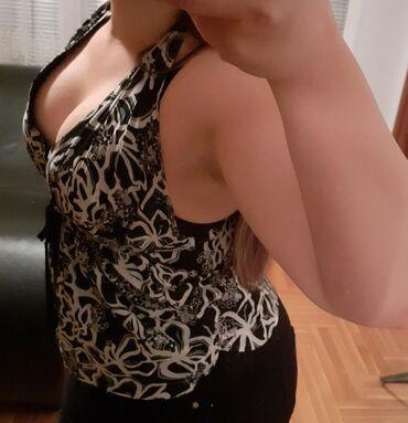 •pogledajte i ostale moje oglaseMajica sa širokim dekolteom i golim
