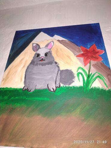 Картина заяц на траве на фоне гор