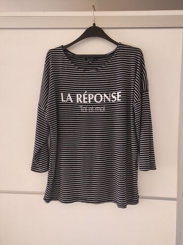New Yorker bluza velicina L. Poluobim grudi 58, duzina 61. Kao nova
