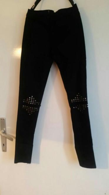 Pantalone  Bikelife jeans sa nitnama na kolena i pocepane . Velicina - Pirot