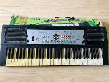 Синтезатор детский игровой.МК 2067 АРаботает от сети и от батареек