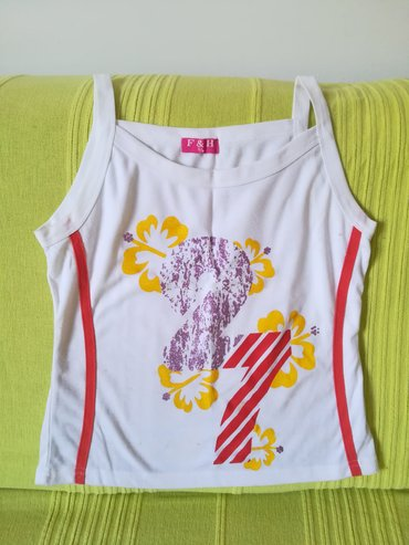 Ženska odeća | Vranje: Pamučna bela majica na bratele vel M, obim ispod grudi 72 cm, dućina