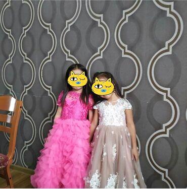 Платья детские от Наиля Байкучукова.Практически новые, носили пару